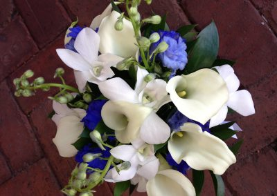 Blue bridal bouquet with white Calla Lillies